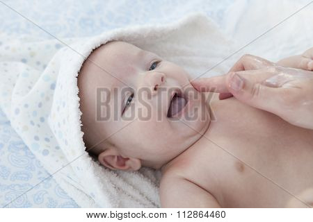 Mother Applying Cream Over Baby Boy