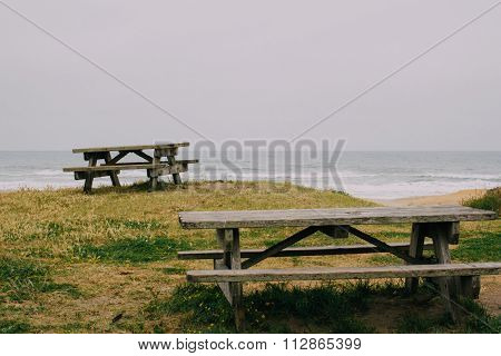 Wooden Benches At Highway One Coast, California, Usa