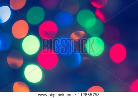 Holiday glowing Abstract Defocused Background With Blinking Lights. Blurred Bokeh. Retro Color Vinta