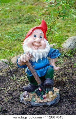 Statue of gnome in garden