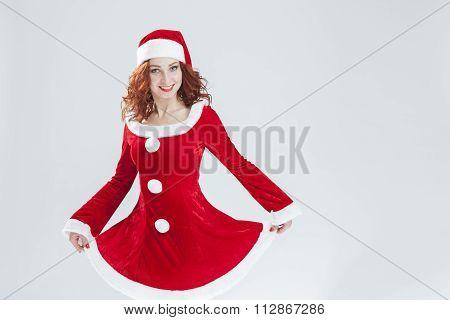 Flirting Caucasian Female Santa Helper in Red Dress