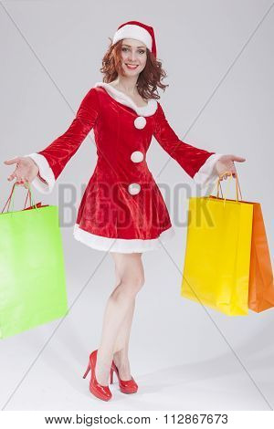 Sexy Female Santa Girl with Shopping Bags