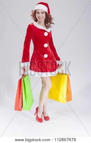 Sexy Female Santa Helper with Shopping Bags