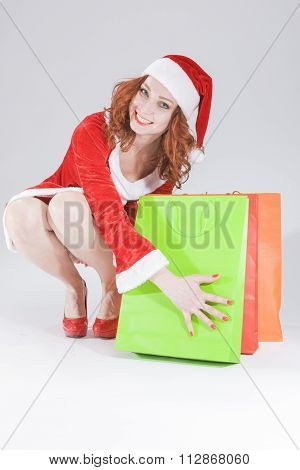 Happy Looking Female SantaHelper with Gifts Bags