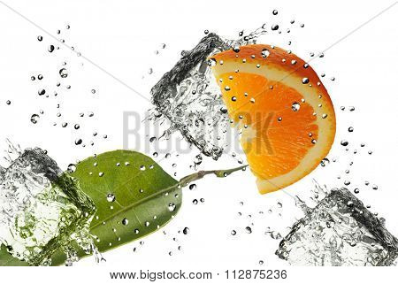 Orange splash with some leafs, ice cubes and drops