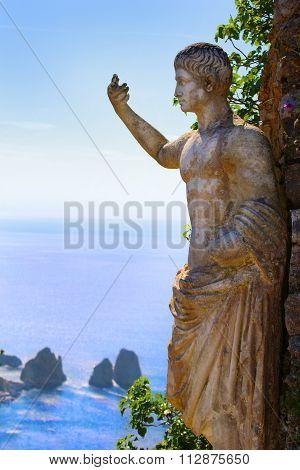 Roman Statue Andthe Faraglioni Rock Formations