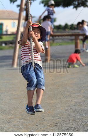 Japanese boy playing with Tarzan rope (4 years old)
