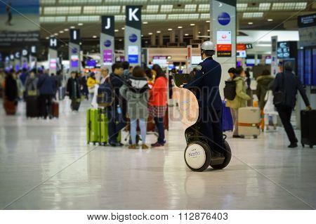 TOKYO JAPAN - NOVEMBER 29 2015: Japanese security guard is on his duty at the terminal two of Narita international airport