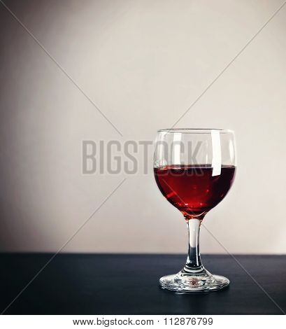 a cocktail on a bar studio shot on a gray background with side lights and reflections and space for text