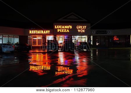 Lucano's Pizza and Great Wok at Night
