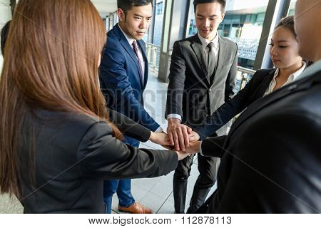 Group of business people joing hands