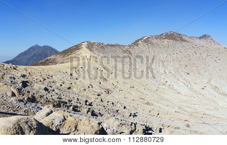 Smoky Desert Mountain Ridge With Blue Sky Background.