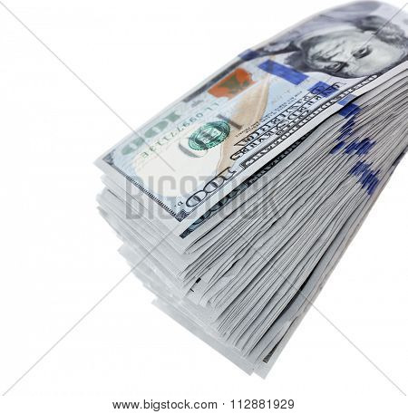 Packed dollar banknotes isolated on white background