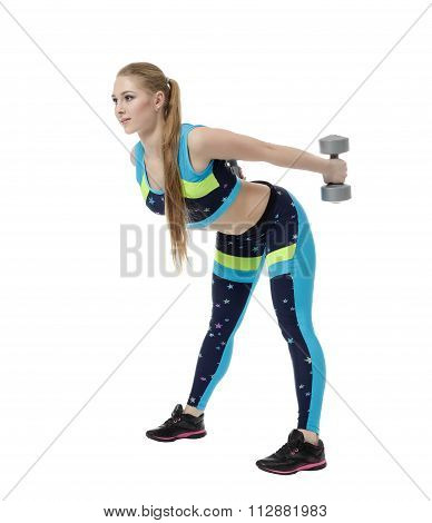 Shaping. Nice girl doing exercise with dumbbells