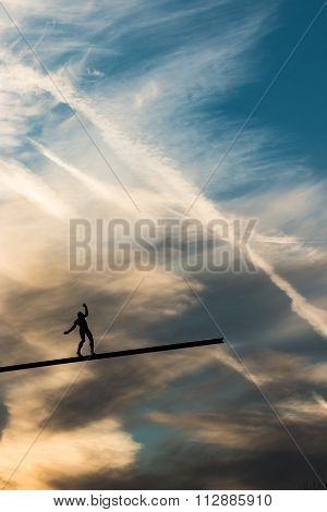 Man keeping balance in the sky