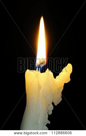 Bent white candle.