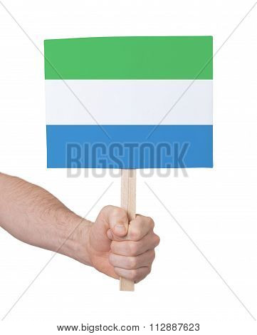 Hand Holding Small Card - Flag Of Sierra Leone