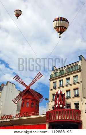 PARIS, FRANCE - SEPTEMBER 12, 2012: Two beautiful balloons flying over Parisian cabaret