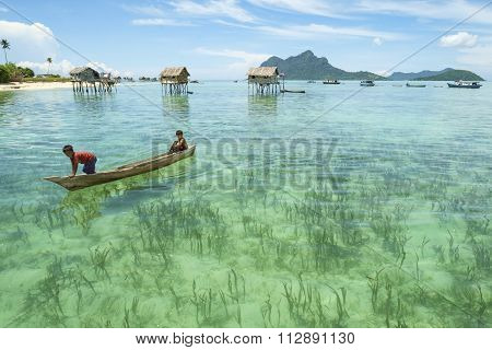 Borneo Sea Gypsy kids on a canoes.