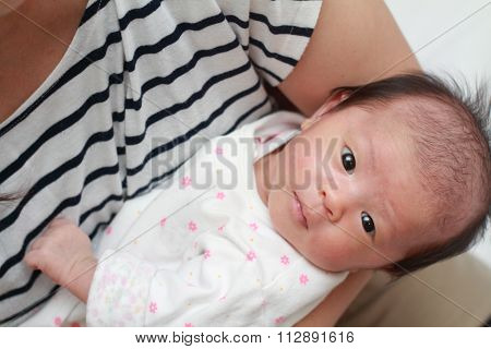 Japanese new born baby girl held by her mother (0 year old)