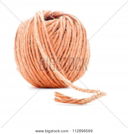Orange fiber clew, crochet thread ball isolated on white background