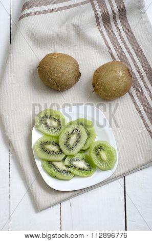 Slices Of Kiwi On White Plate