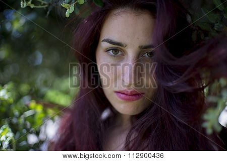 lonely, girl with sad eyes and distressed face outdoor park