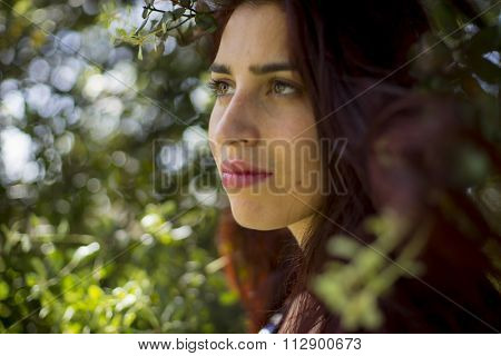 contemplation melancholic girl in a forest in autumn, red long hair