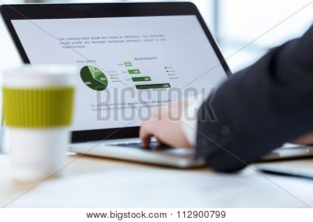 businessman checking financial report on table by using laptop,tablet and mobile phone