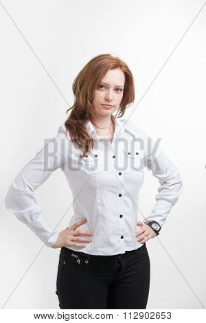Young businesswoman in white blouse, portrait