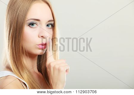 Woman Asking For Silence Finger On Lips