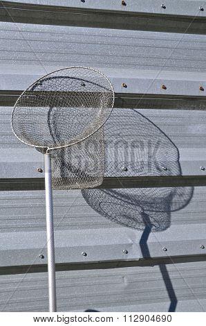Long handled old aluminum fish net