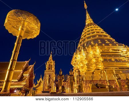 CHIANG MAI, THAILAND - NOVEMBER 22, 2015: Buddhist devotees and tourists visit the Wat Phra That Doi Suthep (temple) at night. This Theravada Buddhist temple is a major tourist attraction.