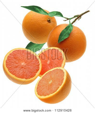 two oranges and three half with green leaves
