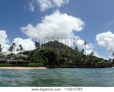 Makalei Beach With Waves Lapping, Napakaa, Lava Rock Wall And Coconut Trees Along The Shore