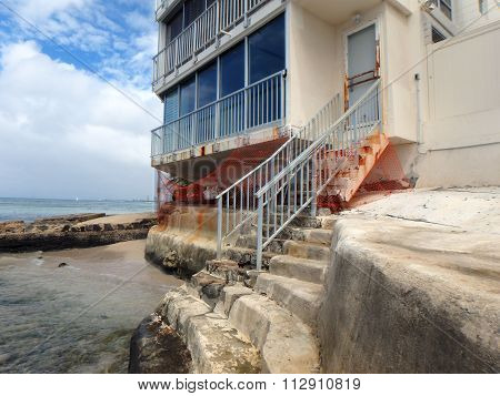 Beach Staircase In Ruins From Sea Level Rise Leading To Highrise Condo