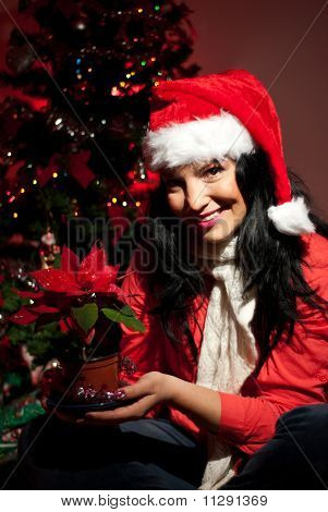 Happy Woman Holding Christmas Flower