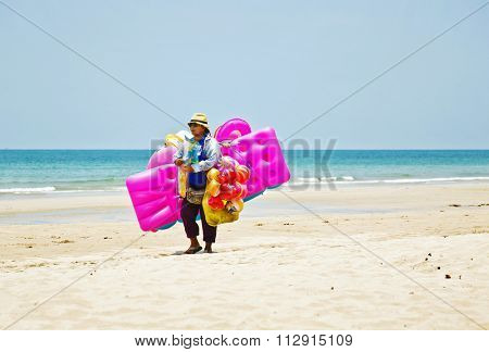 KOH CHANG, THAILAND - APRIL 11, 2015: Seller inflatable mattress on the beach White sand beach in Koh Chang in Thailand. White sand beach is the most popular on Koh Chang, and has a length of 2.5 km