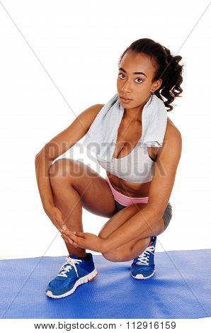 Beautiful Woman Crouching In Sportswear.