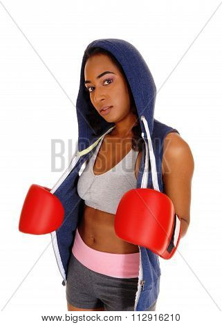 African Woman In Hoodie And Red Boxing Cloves.