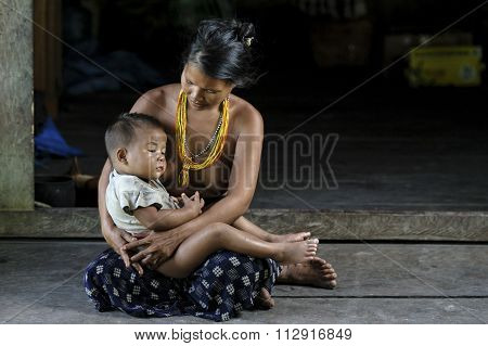 Women of Mentawai tribe with her child.