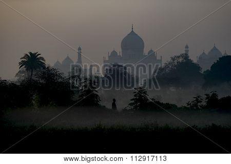 Foggy morning at Taj Mahal during sunrise.