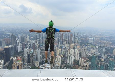 A BASE jumpers in jumps off from Kuala Lumpur Tower.