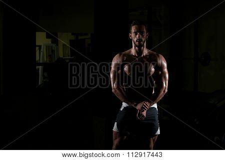 Siluet Young Man Flexing Muscles