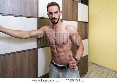 Bodybuilder Changing Clothing In Gym Locker Room