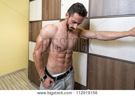 Athlete Changing Clothing In Gym Locker Room