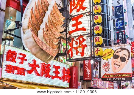 OSAKA, JAPAN - AUGUST 16, 2015: Restaurant and store signs in the Dotonbori District. The area is a famous tourist attraction.