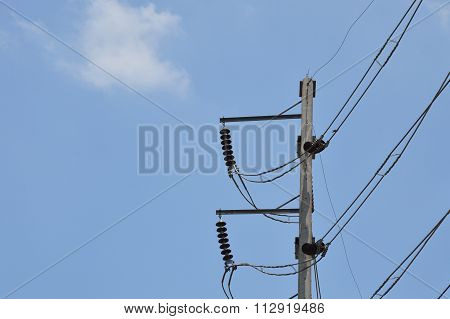 high voltage electric pole on sunny day