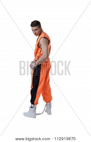 Bad guy posing in prison uniform and handcuffs