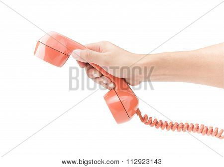 Hand Holding Orange Telephone  On White Background With Clipping Path